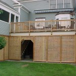Rear view with cedar railings and full lattice.