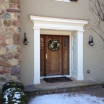 Rotted existing trim led to a re-design of the entry with new Stucco work and a Azek trim detail.